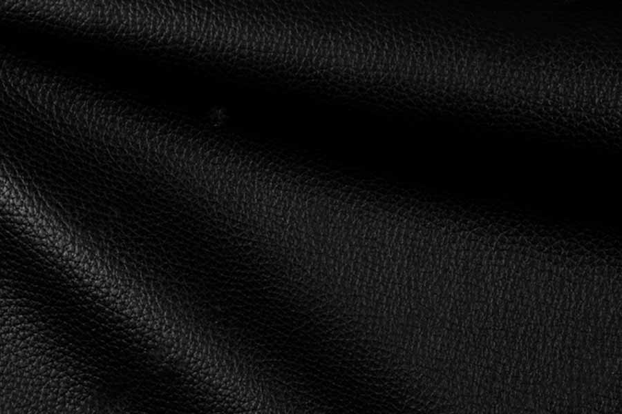 Bright Natural Real Black Leather with Flexes Dark Waves Background Texture