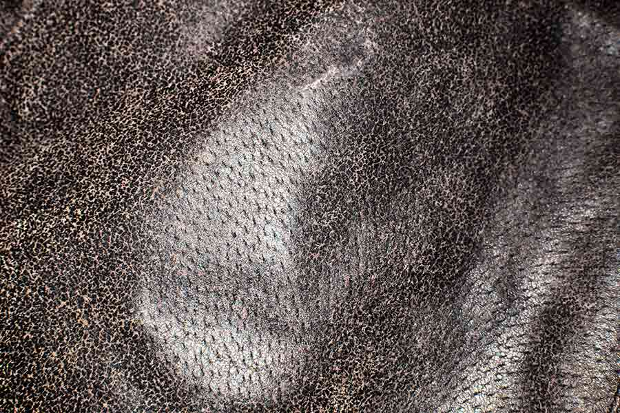 Texture of leather fabric with fur