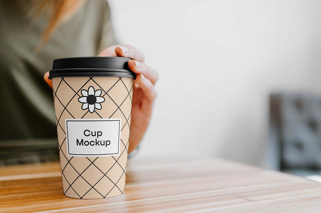 Coffee Cup with Hand Mockup