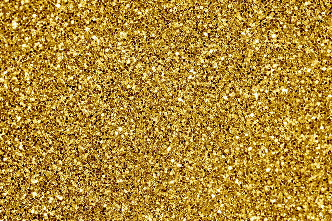 Close-up of Golden Glitter Textured Background