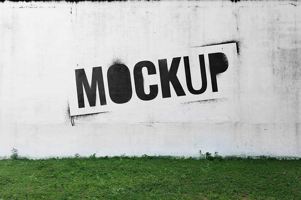 Cement yard wall mockup with graffiti Premium Psd